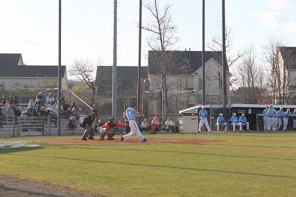 Junior Michael Kuzbel swings