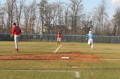 Sophomore Dave Mocabee runs for second base