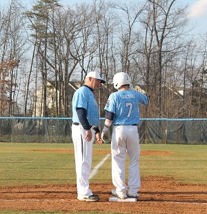 Sophomore Elijah Quiceno talks with his first base coach