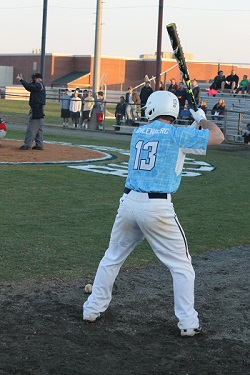 Sophomore Josh Greenberg warms up before batting