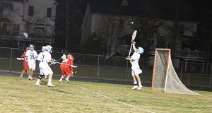The Bulldogs play defense and senior Brian Failor saves a goal