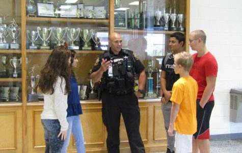 SRO Deputy Jones talks to students about the importance of school safety and his job at Stone Bridge.