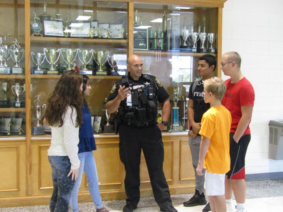 SRO+Deputy+Jones+talks+to+students+about+the+importance+of+school+safety+and+his+job+at+Stone+Bridge.
